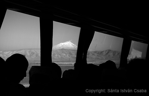 Man sleeping on the bus at Istanbul-Teheran route which takes 40 hours (in the background the 5165 m high Ararat mountain).